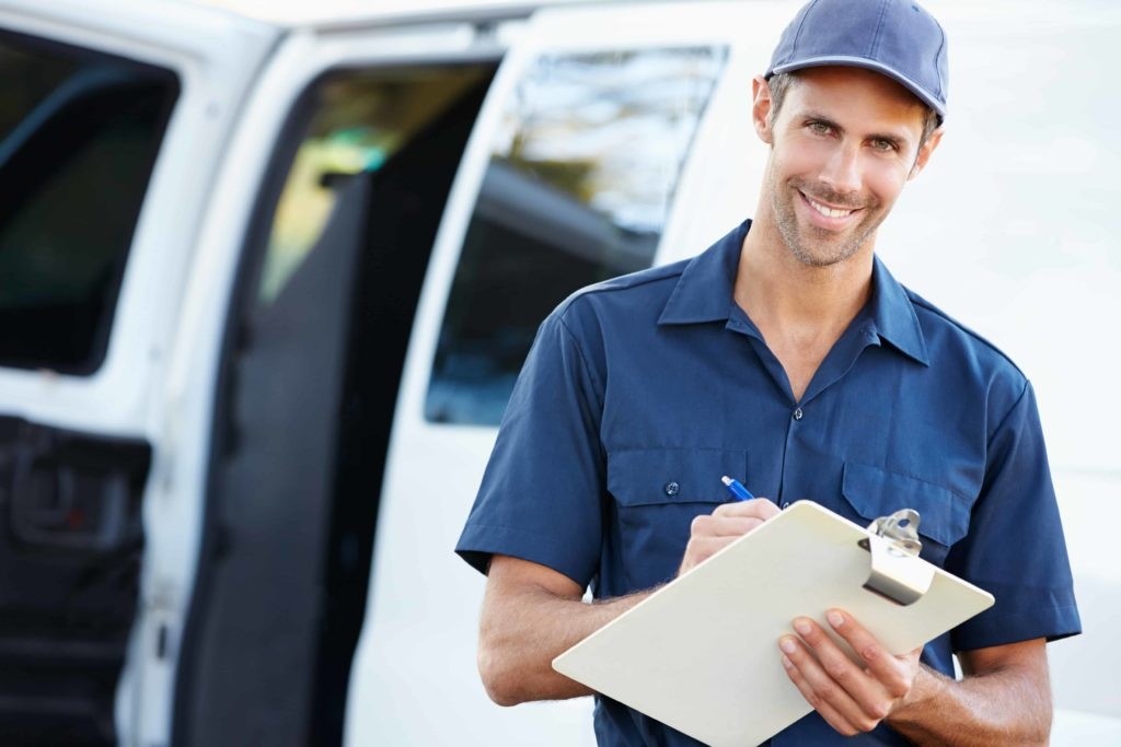 portrait-of-delivery-driver-with-clipboard